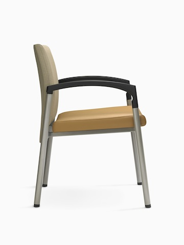 Profile view of a Valor Stack Chair with an orange seat, beige back, steel frame, and black arms.