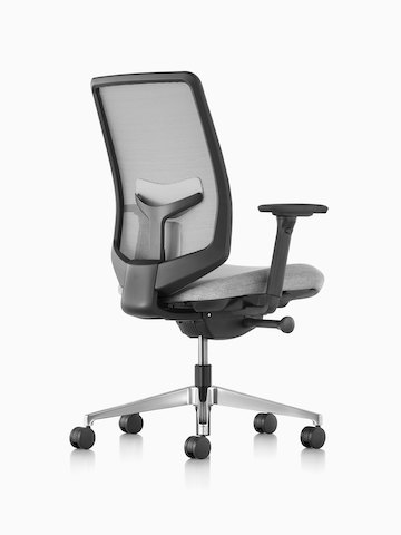 Three-quarter rear view of a gray Verus office chair with a suspension back and upholstered seat.