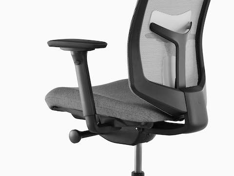 Gray Verus office chair with a suspension back and upholstered seat, showing adjustable arms and back support.
