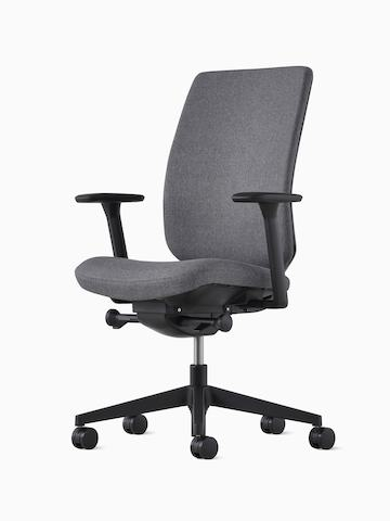 A Verus Chair with a dark gray upholstered seat and dark gray upholstered back.