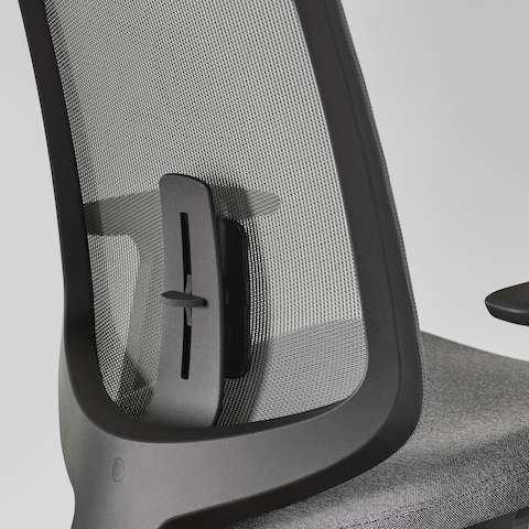 A close-up view of a Verus Chair with a black suspension back and adjustable lumbar support.