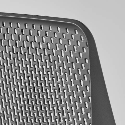 A close-up view of a Verus Chair's black Triflex back.
