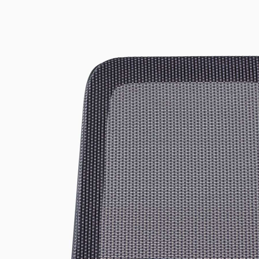 A close-up view of a Verus Chair's black suspension back.