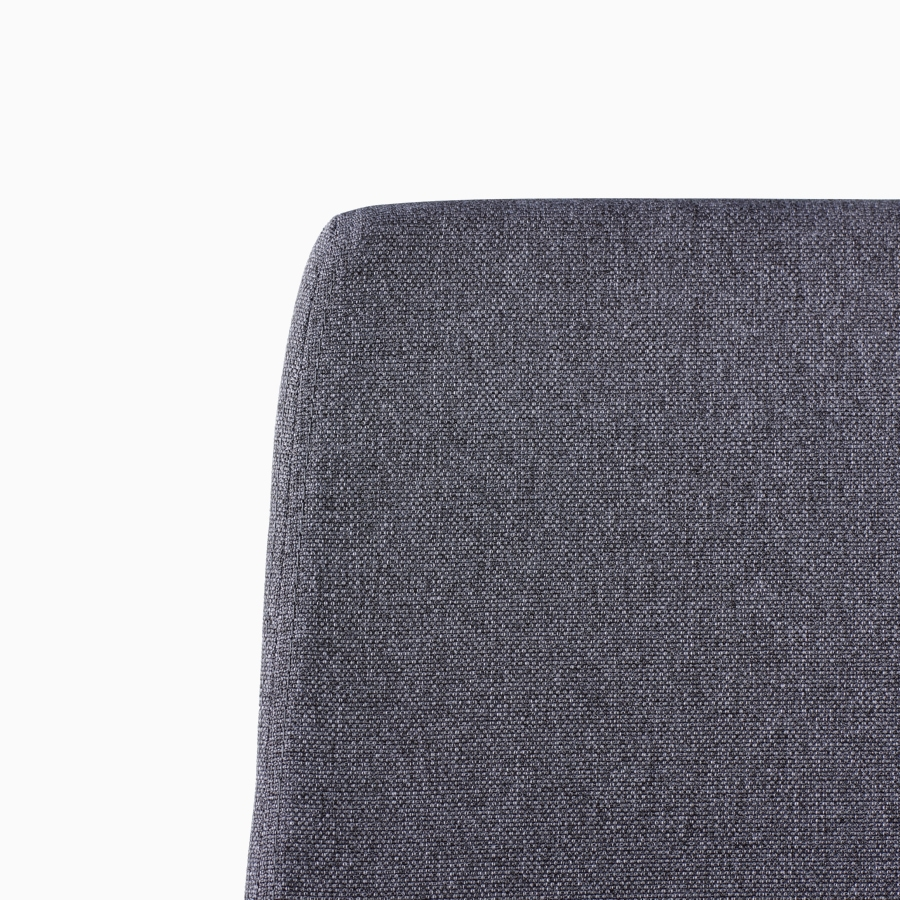 A close-up view of a Verus Chair's black upholstered back.