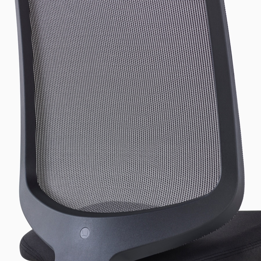 A close-up view of a Verus Chair's black suspension back with no additional support.