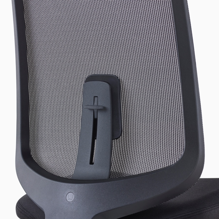 A close-up view of a Verus Chair's black suspension back with adjustable lumbar support.