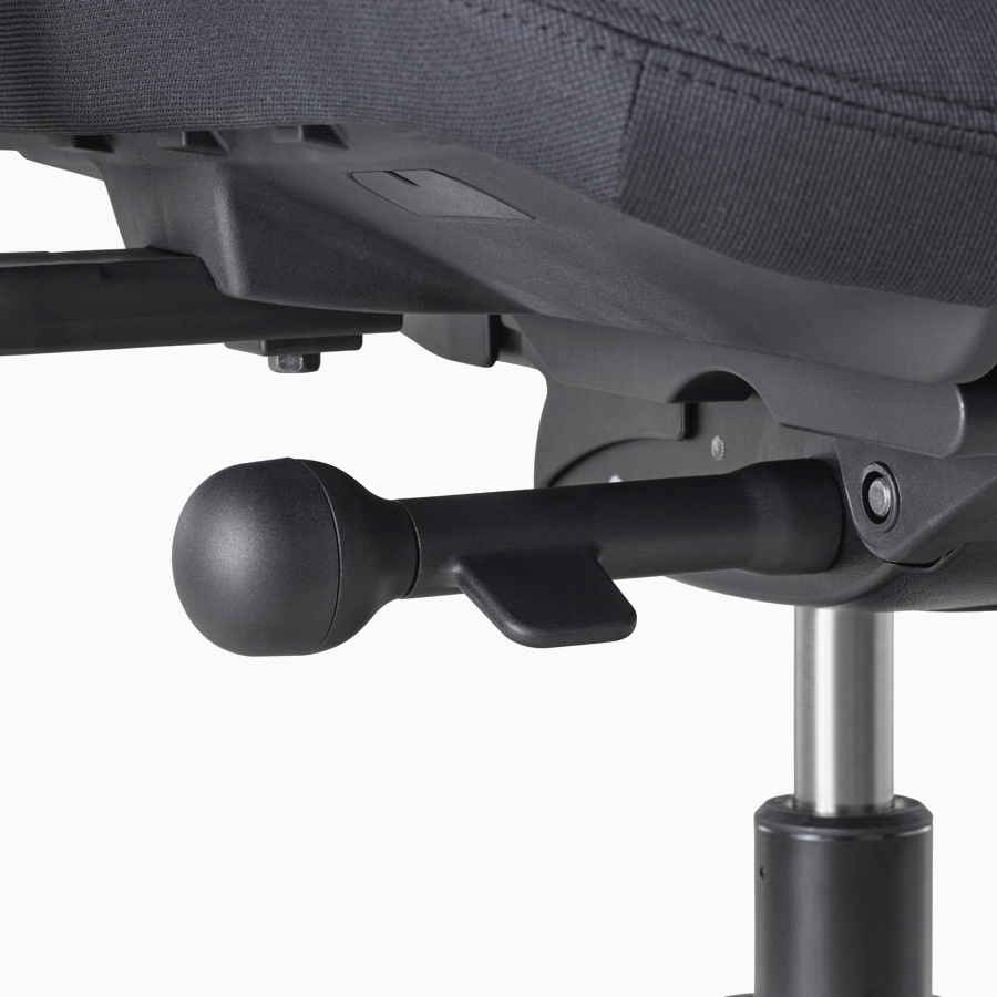 A close-up view of a Verus Chair's black adjustment knob.