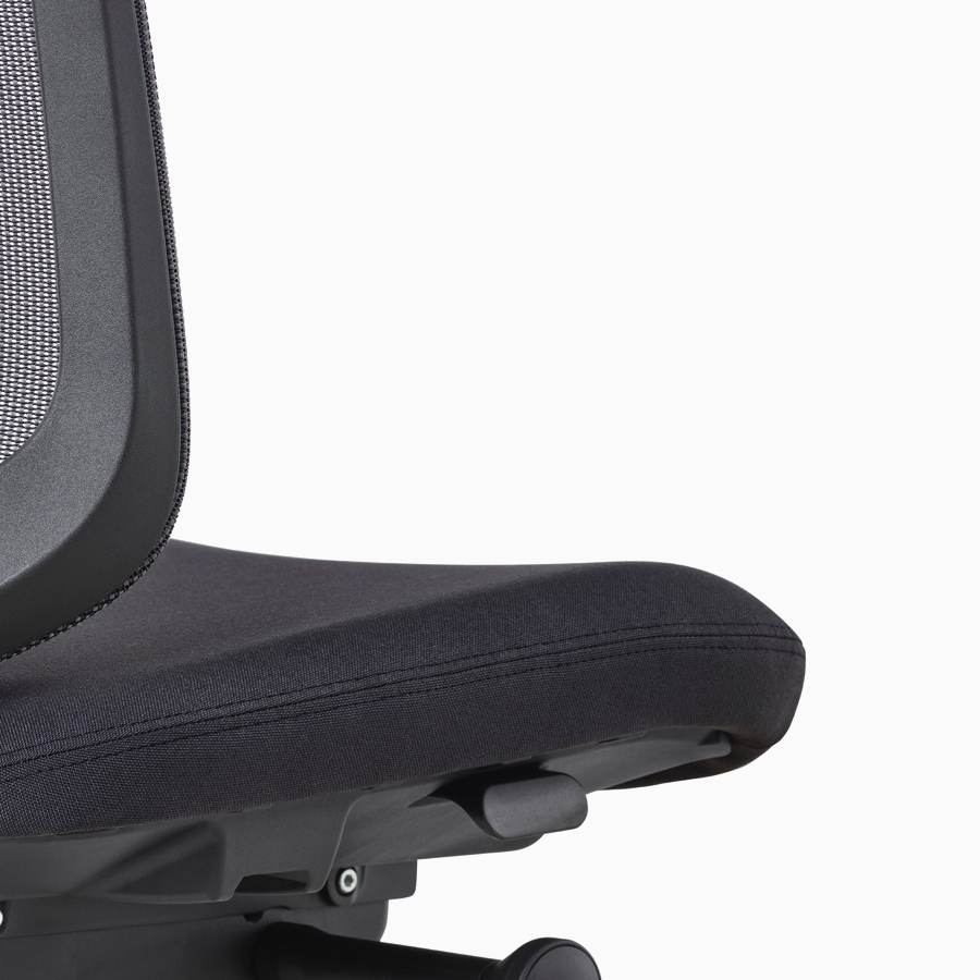 A close-up view of a black Verus Chair with no arms.