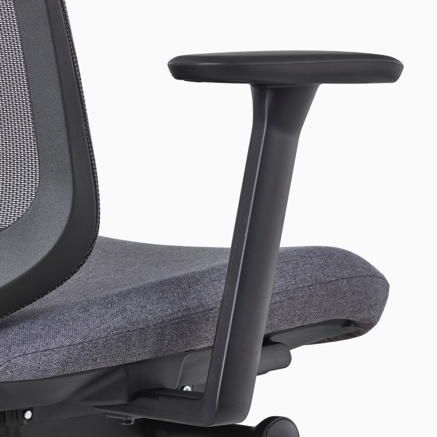 A close-up view of a Verus Chair's black fixed arm.