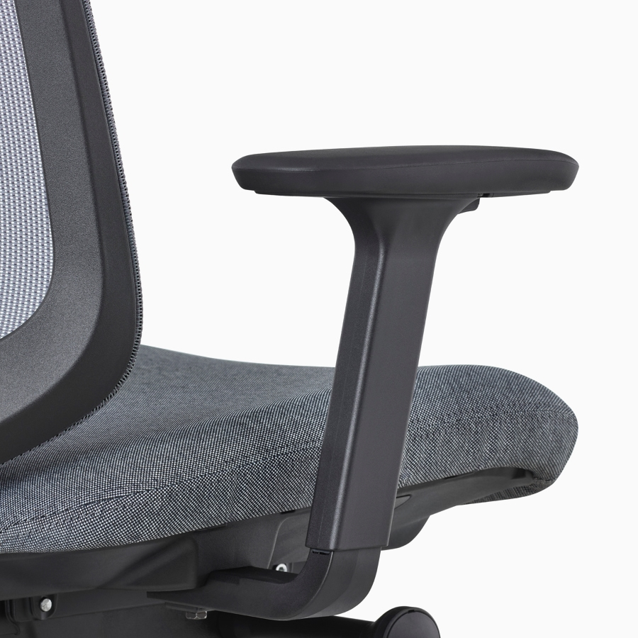 A close-up view of a Verus Chair's black adjustable-height arm.