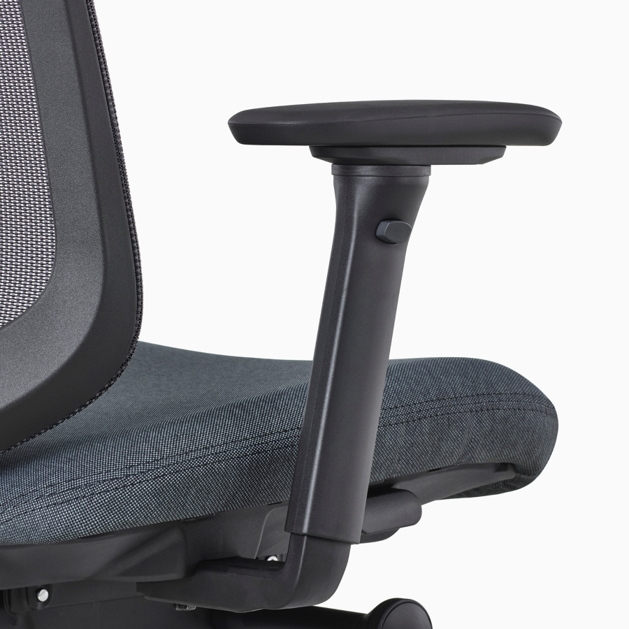 A close-up view of a Verus Chair's black fully-adjustable arm.