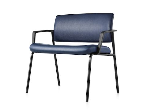 An angled view of a Verus Plus Chair with arms upholstered in blue vinyl.