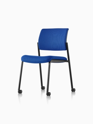 Armless Verus Side Chair with blue upholstery and casters, viewed from a 45-degree angle.