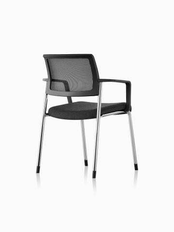 Three-quarter rear view of a black Verus Side Chair.