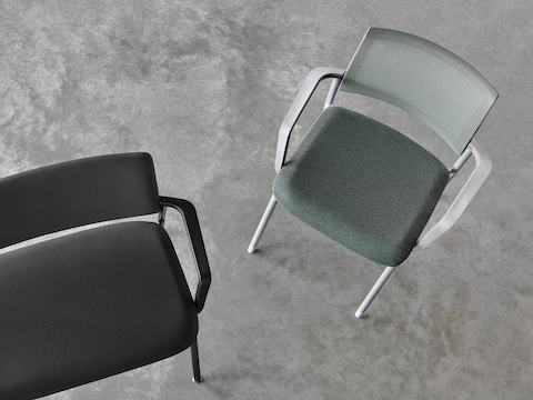 An overhead view of a black Verus Side Chair next to a green Verus Side Chair.