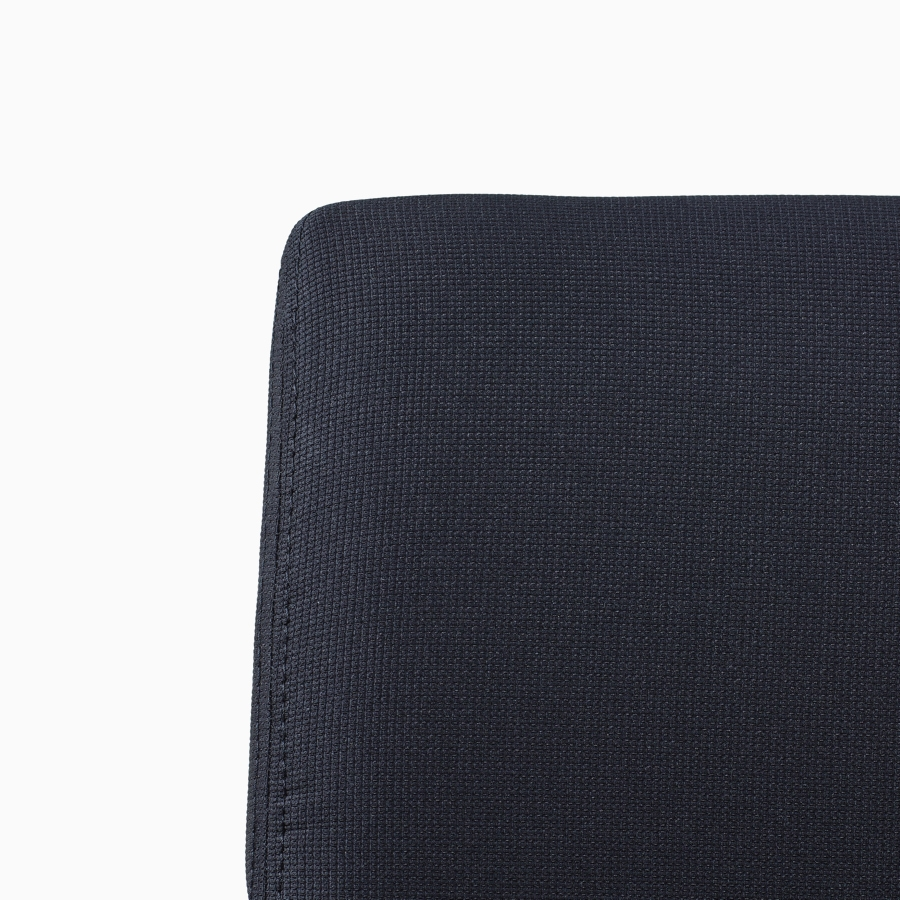 A close-up view of a Verus Side Chair's black upholstered back.