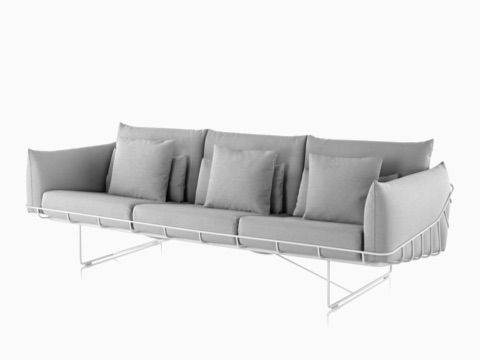 Gray three-seat Wireframe Sofa with white frame, viewed from an angle.