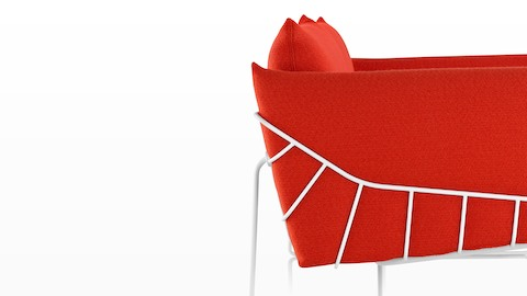 Profile view of a red Wireframe lounge chair.