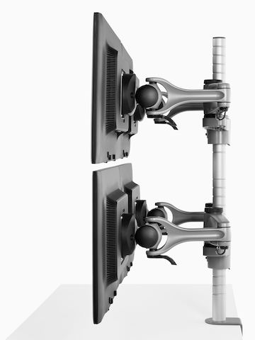 Profile view of four monitors attached to a single Wishbone Monitor Arm post.