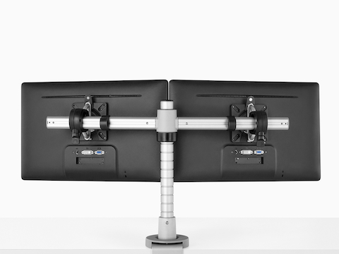 Rear view of two side-by-side monitors attached to a single Wishbone Monitor Arm post.