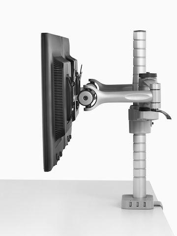 Profile view of two side-by-side monitors attached to a single Wishbone Monitor Arm post.