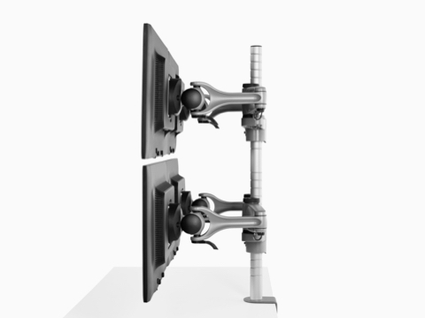 Profile view of four monitors attached to a single heavy-duty Wishbone Plus monitor arm post.