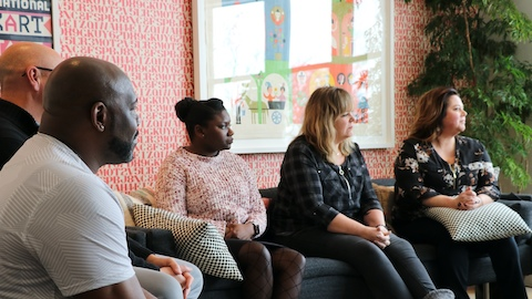 A diverse group of Herman Miller Group employees meet in the Nelson Room at the Herman Miller Design Yard in West Michigan to discuss ideas for helping the organization become more diverse, equitable, and inclusive.
