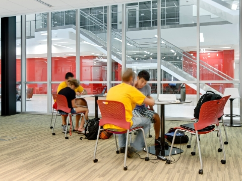 College students study while seated in Caper chairs.