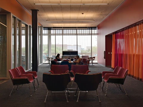 A student study lounge full of natural light and Swoop furnishings.