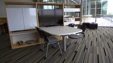 A campus lounge area outfitted with Canvas Group components and Caper chairs.