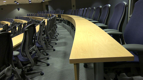 A forum inside K-state Olathe outfitted with curved tables and Celle chairs.