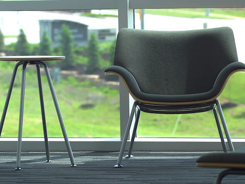 Swoop lounge furnishings sit in front of a large window.