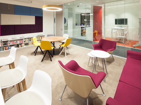 An informal meeting area featuring red Swoop Lounge Furniture.