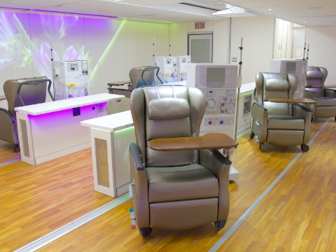 A row of Nemschoff Serenity Chairs sit amidst dialysis machines.