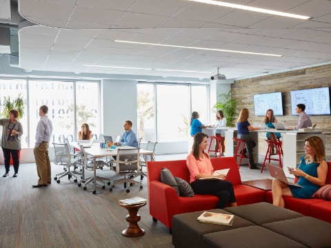 People work and converse in an open office setting with Setu chairs and lounge seating.