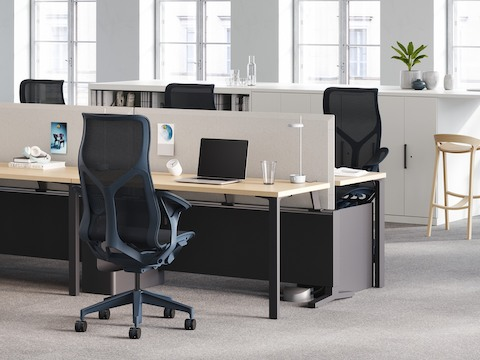 A Canvas Dock workstation, with four high-back Cosm chairs, is a source of power for a Logic Reach round system start.
