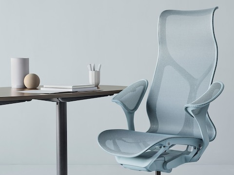 Cosm high back chair in light blue at a table.