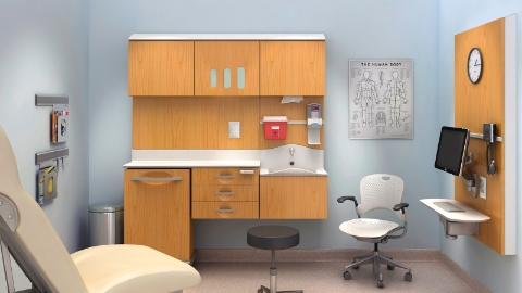 An organized exam room outfitted with Compass furnishings and a Caper chair.