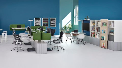 An open workspace setup with private workstations, standings desks, and communal seating options.