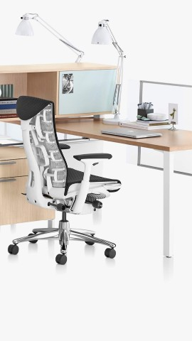A Canvas Office Landscape workstation with a black Embody office chair. Select to go to the workspaces landing page.