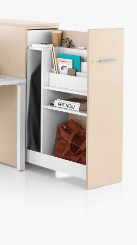 A vertical Tu Storage unit, open to reveal the contents. Select to go to the storage landing page.