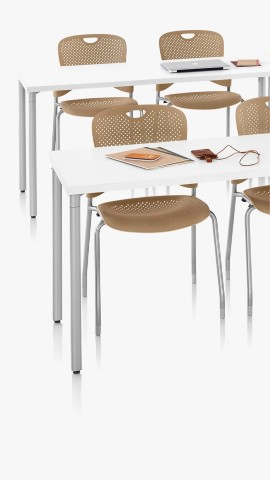 White Everywhere Tables with brown Caper Stacking Chairs. Select to go to the tables landing page.