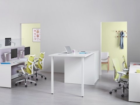 A healthcare administrative area equipped with benching work areas, green Mirra 2 Chairs, and a standing-height collaboration surface.
