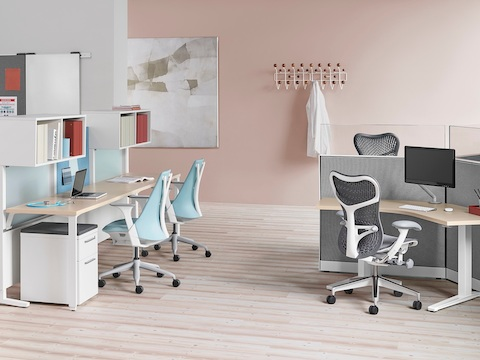 Light blue Sayl office chairs and gray Mirra 2 office chairs in a healthcare administrative area.