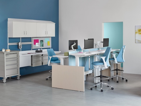 Modular Co/Struc System storage components and light blue Sayl stools in a healthcare administrative area.