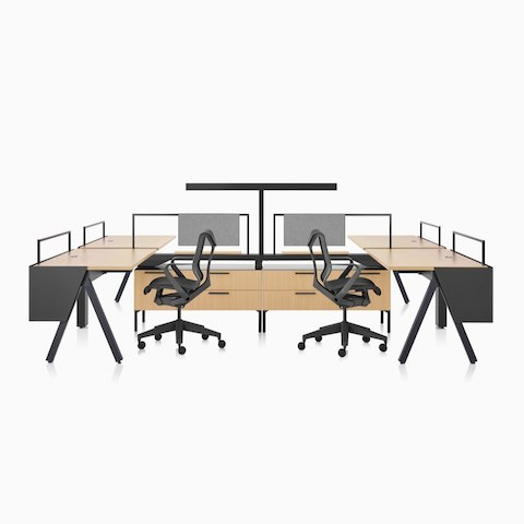 A Canvas Vista workstation with a-shaped legs, modesty screens, a t-shaped light, and black Cosm office chairs.