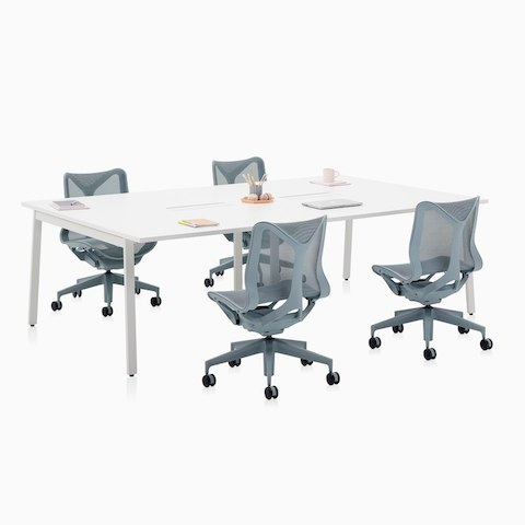 A Layout Studio meeting table with power access and four low-back Cosm Chairs in gray.