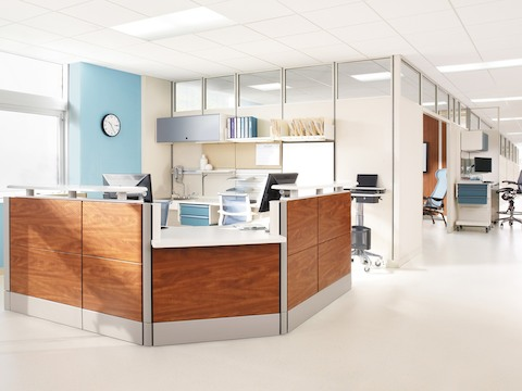 An Ethospace Nurses Station with tiles in a woodgrain finish anchors a patient floor.