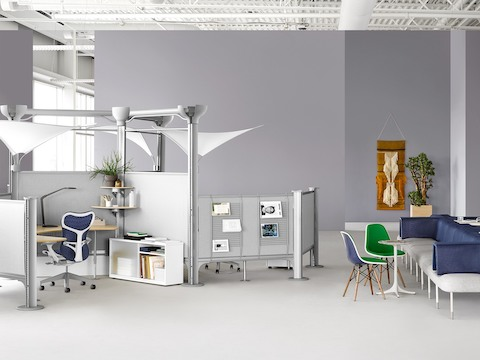 A collaborative healthcare setting that includes a workstation with Resolve screens and group seating from Public Office Landscape.