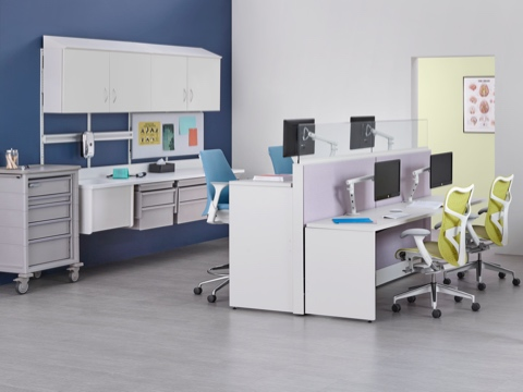 Co/Struc modular storage components, light blue Sayl stools, and green Mirra 2 office chairs in a caregiver work environment.